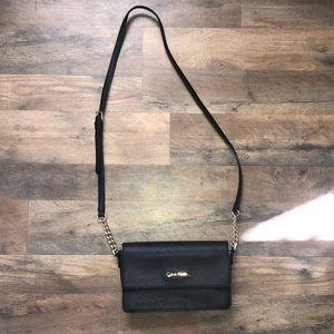 Black Calvin Klein purse with gold details